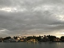 A look over the bay at yachts and mansions in Miami Beach, Florida. Miami is an international city at Florida`s southeastern tip. Its Cuban influence is Stock Photo