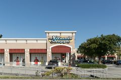 Front of the Vitamin Shoppe retail shop on a sunny day. Facade of the Vitamin Shoppe store with a parking lot in front royalty free stock photos