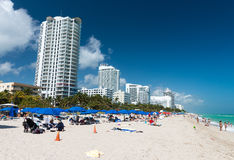 MIAMI - JANUARY 2016: People relax on South Beach. Miami Beach i. S a popular destination for locals and tourists Royalty Free Stock Images
