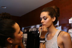 MIAMI - JULY 19: Model getting ready backstage at Caitlin Kelly Swimwear collection Stock Image