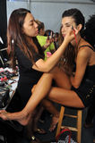 MIAMI - JULY 19: Model during hair and makeup process and first looks backstage at the Agua Bendita Collection Stock Image