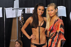 MIAMI - JULY 19: Models get ready backstage at the Agua Bendita Collection for Spring/ Summer 2014 Stock Image