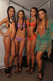 MIAMI - JULY 20: Models getting ready for the show at the Agua Di Lara 2014 Collection backstage Stock Photos