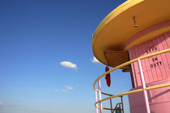 Miami Lifeguard Station. Pink and yellow lifeguard station with blue sky stock images