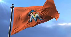 Miami Marlins flag, american professional baseball team, waving - loop. Flag of the team of the Miami Marlins, american professional baseball team, waving at stock video