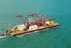Miami port - water cleaning barge Royalty Free Stock Image