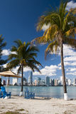 Miami Skyline. With palm trees, chairs and umbrellas from South beach in a sunny day with clouds - Miami (USA - 2010 royalty free stock images