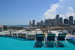 Miami Skyline from a cruise ship. Empty chairs waiting for vacationers to enjoy the Miami skyline Stock Photo
