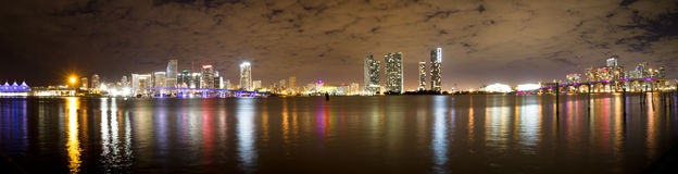 Miami skyline at night. The coloured Miami skyline with inverted reflection in water at night. Photo taken in December Stock Photography