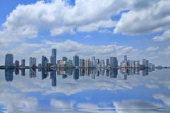 Miami skyline Reflection. Miami skyline with a reflection of clouds and blue sky Stock Photo
