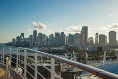 Miami Skyline and shipping docks from cruise ship with cruise ship board foreground stock photo