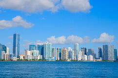 Miami skyline viewed from Biscayne Bay Florida. Colorful photo of the Miami skyline as viewed off of the coastline in Biscayne Bay, Florida on a blue sky sunny stock photography
