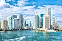 Miami skyline. Yachts sail on sea water to city Stock Image