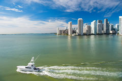 Miami skyscrapers with blue cloudy sky, boat sail, Aerial view Stock Photos