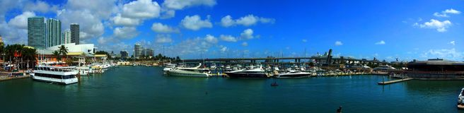 Miami skyscrapers with bridge over sea in the day. Stitched Panorama-Miami skyscrapers with bridge over sea in the day with yaht parking and port with cruise stock photography