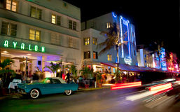 Miami south beach nightlife. Cars whizz by Avalon hotel and other art deco architecure on Ocean Drive, Miami South Beach Stock Photos