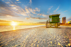 Miami South Beach sunrise. With lifeguard tower and coastline with colorful cloud and blue sky Stock Photo