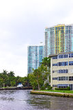 Miami suburb with residential buildings, palm trees and marine transport. Royalty Free Stock Photos