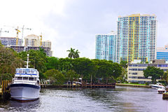 Miami suburb with residential buildings, palms and marine transport. Stock Photo