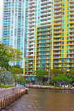 Miami suburb with residential buildings and palms near the canal. Royalty Free Stock Photo