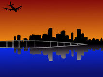 Miami at sunset with plane. Miami Florida skyline reflected at sunset with plane Stock Photography
