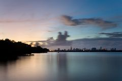 Miami at Sunset, from Water. Miami, seen framed by its natural environment: mangroves and calm waters Royalty Free Stock Photo