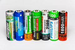 Standing AA rechargeable batteries. Miami, US - JANUARY 18, 2018: Diverse rechargeable batteries on the table standing vertical Royalty Free Stock Image