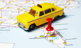 Miami USA map taxi. Close up of Tampa Florida USA map with red pin and taxi toy - Travel concept stock photos