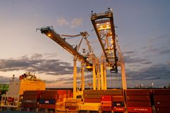 Miami, USA - March 01, 2016: cranes and cargo containers stacked in port. Container port or terminal with night. Illumination. Shipping and delivery of goods royalty free stock photography