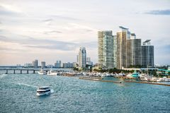 Miami, USA - March, 18, 2016: downtown skyline on sea shore. Skyscraper building on cloudy sky. Architecture, structure, design. B stock photography