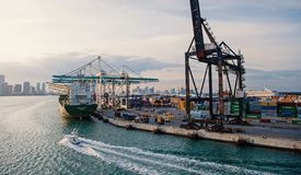 Maritime container port with cargo ship, cranes. Sea port, terminal or dock. Freight, shipping, delivery, logistics stock photos