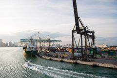 Miami, USA - March, 18, 2016: maritime container port with cargo ship, cranes. Sea port, terminal or dock. Freight, shipping, deli royalty free stock image