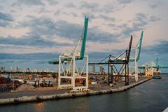 Miami, USA - March 01, 2016: maritime container port with cranes and cargo containers. Port or terminal on cloudy sky royalty free stock photo
