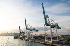 Miami, USA - March, 18, 2016: sea port, terminal or dock. Maritime container port with cargo ship, cranes. Freight, shipping, deli royalty free stock photos