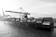 Miami, USA - March, 18, 2016: ship with cargo containers and crane in sea port. Maritime container port, dock or stock image