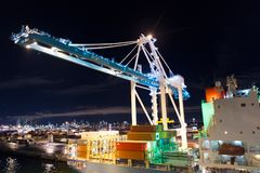 Miami, USA - November, 23, 2015: freight, shipping, delivery, logistics, merchandise. Maritime container port with cargo container. S, cranes at night. Port or Stock Photography