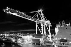 Miami, USA - November, 23, 2015: freight, shipping, delivery, logistics, merchandise. Maritime container port with cargo. Containers cranes at night Port or Royalty Free Stock Photo