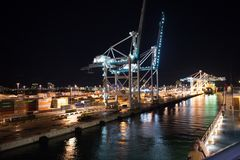 Miami, USA - November, 23, 2015: maritime container port with cargo containers, cranes at night. Port or terminal with night illum. Ination. Freight shipping Stock Images