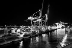 Miami, USA - November, 23, 2015: maritime container port with cargo containers, cranes at night. Port or terminal with. Night illumination. Freight, shipping Royalty Free Stock Photography