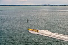 Speedboat move fast on sea water. Speed, extreme, energy, power. Boat, vessel, transport. Wanderlust, travel, vacation. Miami, USA - November 22, 2015: speedboat royalty free stock images