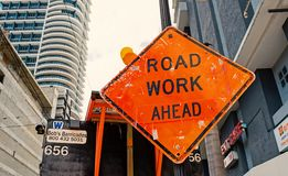 Miami, USA - October 30, 2015: construction sign on city road. Road work ahead warning and safety. Transportation. Traffic and travel. Caution and warn concept royalty free stock images