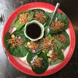 Miang kham. Is made from wrapping various ingredients into wild piper leaves & x28;chaphlu, ชะพลู, Piper sarmentosum, wild betel& x29;, composing a Royalty Free Stock Images