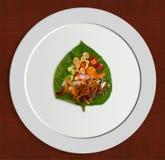 Miang Kham, Thai savoury bite-size leaf-wrapped appetizer Stock Photos