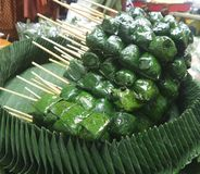 Miang Kham. Thailand traditional snack. It consist of raw fresh Piper sammentosum leaves that are filled with roasted coconut shaving and many ingredients Stock Image
