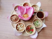 Miang kham is a traditional snack from Thailand and Laos.Food wrapped in leaves of lotus petals, closeup. Asian food, Thai food: Miang kham, a traditional snack royalty free stock image