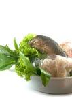Miang Kum fish (Leaf-Wrapped Bite-Size Appetizer Mackerel). On white Royalty Free Stock Photo