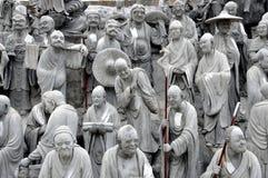 Mianyang, China: De Beeldhouwwerken van tableaus bij Tempel stock foto's