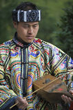 Miao nationality man. A Miao nationality man is playing the two-string fiddle at Miao nationality New Year in Leishan county, Guizhou province of China royalty free stock photography