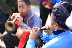 Miao nationality men playing music instrument Royalty Free Stock Photos