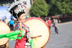 Miao nationality woman beat a drum. And dance to celebrate the local festival at fenghuang ancient town,china oct,13,2013 stock photography